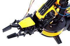 胳膊黑色特写镜头机器人黄色 免版税库存图片