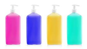 胶凝体的,化妆水,奶油,香波,从桃红色化妆塑料瓶的浴液体色的容器有白色分配器泵浦的 库存照片