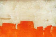胶合板板料是被绘的橙色油漆 免版税库存照片