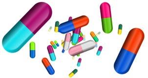 胶囊,颜色药片和片剂落 免版税库存照片