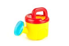 能塑料红色玩具浇灌的黄色 免版税库存图片