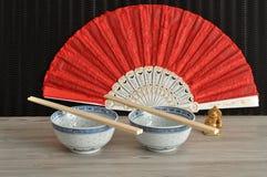 脊椎碗、筷子、手爱好者和菩萨 免版税库存照片