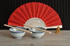 脊椎碗、筷子、手爱好者和菩萨 免版税库存图片