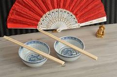 脊椎碗、筷子、手爱好者和菩萨 库存图片