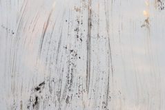 脏的白色背景玻璃绘与白色油漆 库存图片