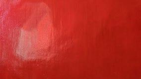脏的红色使有肋骨混凝土被绘的墙壁背景有大理石花纹 免版税图库摄影
