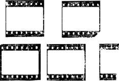 脏的胶卷软片,空白的画框 库存照片