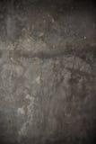 脏的破裂的水泥墙壁 免版税库存照片