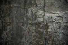 脏的破裂的水泥墙壁 库存图片