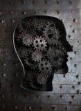 脑子概念:金属齿轮和嵌齿轮在头 免版税库存照片