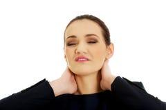 脖子痛妇女 免版税库存照片