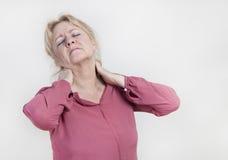 脖子痛妇女 库存照片