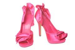 脚跟变粉红色被翻动的缎 图库摄影