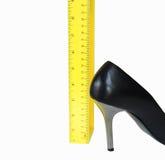 脚跟英寸三 免版税库存照片