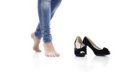 脚跟高牛仔裤 免版税库存照片