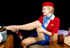 脱下衣服减速火箭的空中小姐 免版税库存照片