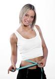 腹部女孩她评定的年轻人 免版税图库摄影