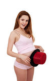 腹部帽子她摆在的怀孕的显示妇女 免版税库存照片
