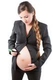 腹部怀孕女实业家的标记写道 免版税库存图片