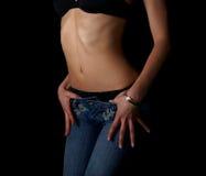 腹部性感的妇女 库存图片
