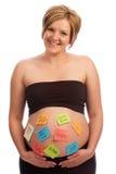 腹部愉快的附注怀孕的粘性妇女 免版税图库摄影