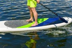 腿供以人员实践的桨03 免版税库存照片