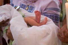 腿婴孩洗礼 免版税图库摄影
