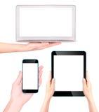 膝上型计算机、数字式片剂和手机用手 库存照片