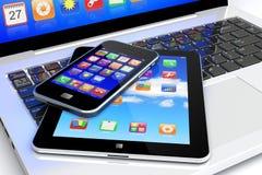 膝上型计算机、片剂个人计算机和智能手机 免版税库存照片