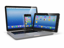 膝上型计算机、电话和片剂个人计算机。 电子设备 免版税库存图片