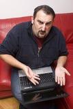 膝上型计算机人翻倒 库存图片