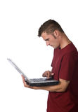 膝上型计算机人运作的年轻人 免版税库存图片