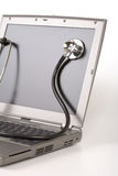 膝上型计算机听诊器 免版税图库摄影