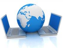 膝上型计算机和地球概念 免版税库存照片