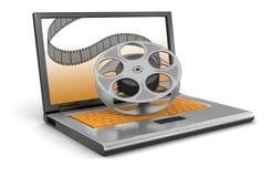 膝上型计算机和影片小条(包括的裁减路线) 库存照片