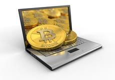 膝上型计算机和bitcoins 库存照片