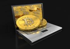 膝上型计算机和bitcoins 库存图片