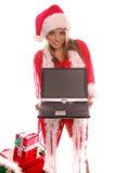 膝上型计算机圣诞老人夫人 库存照片