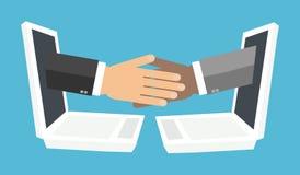 从膝上型计算机屏幕的握手 免版税库存照片