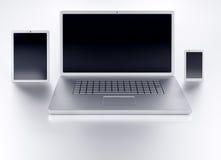 膝上型计算机片剂和智能手机有黑空的屏幕正面图 免版税库存图片