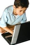 膝上型计算机男小学生使用 免版税库存图片