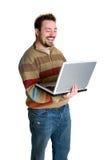 膝上型计算机笑的人 免版税库存照片