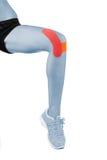 膝盖对待与磁带疗法 免版税库存图片