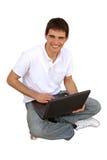膝部使用年轻人的人顶层 免版税库存照片