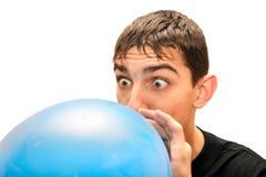 膨胀少年的气球 免版税库存图片