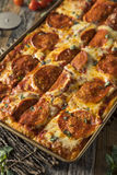 自创意大利辣味香肠西西里人的平底锅薄饼 库存图片