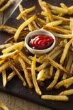 自创烤箱被烘烤的炸薯条 库存图片