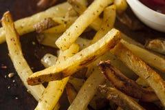 自创烤箱被烘烤的炸薯条 图库摄影