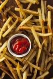 自创烤箱被烘烤的炸薯条 免版税库存照片