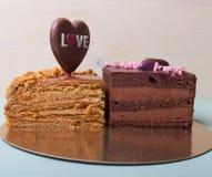 自创蛋糕片断与另外华伦泰` s天装饰的 库存图片
